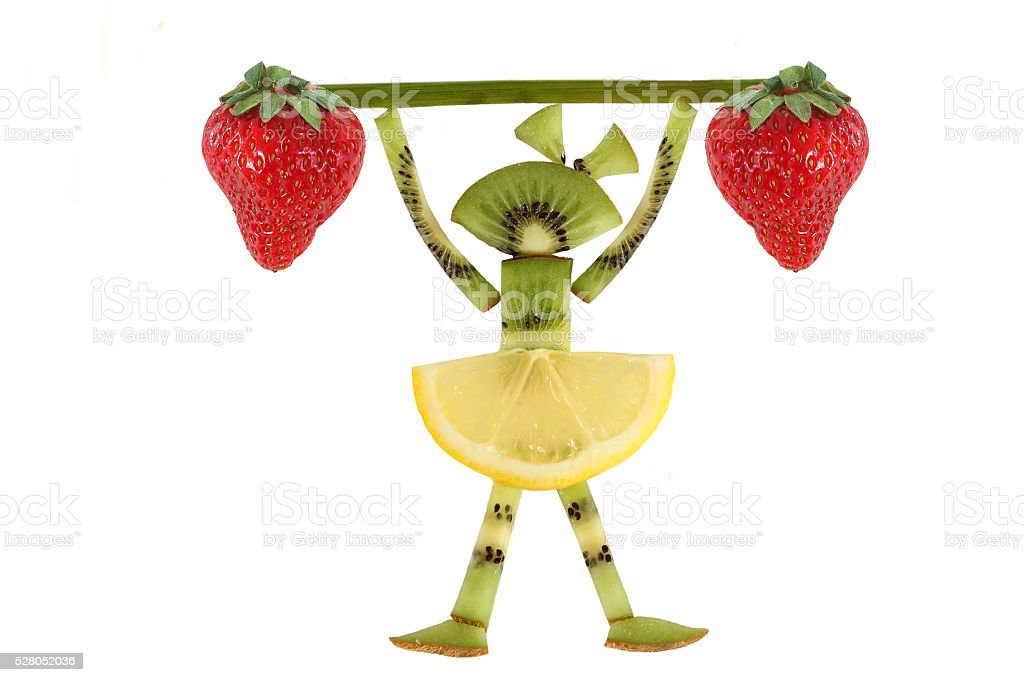 Creative food concept. Funny little girl  with slices of kiwi. stock photo