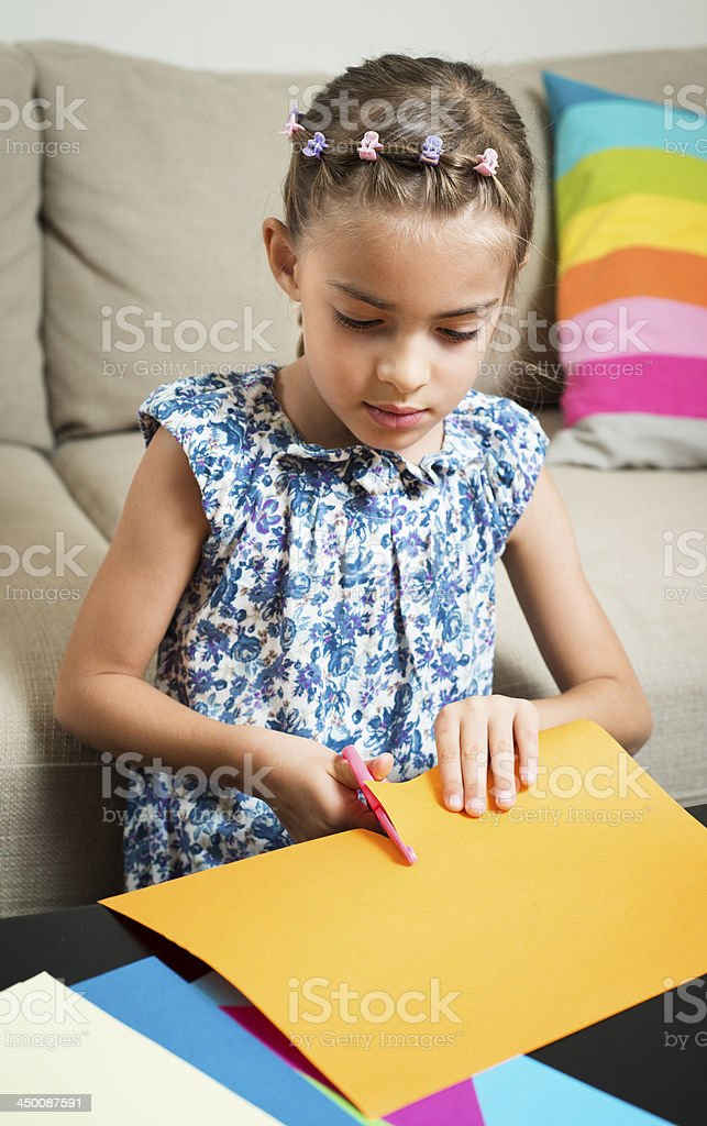 Creative girl cutting paper royalty-free stock photo