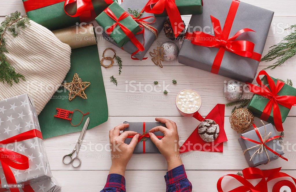 Creative diy hobby. Making bow on modern handmade christmas present,...