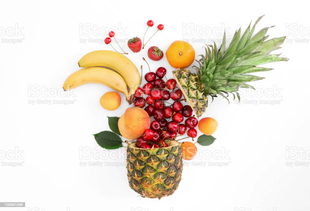 Creative layout made of summer fruits on a white background stock photo