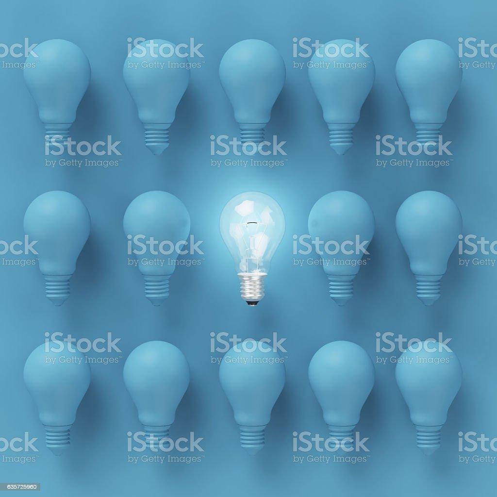 Creative light bulb Idea concept on blue background stock photo