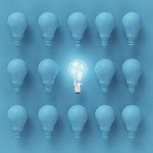 Creative light bulb Idea concept on blue background