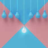 Creative light bulb Idea concept on blue  pink pastel background