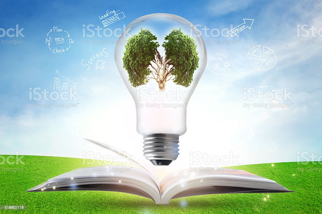 Creative light bulb over textbook with strategy plan. stock photo