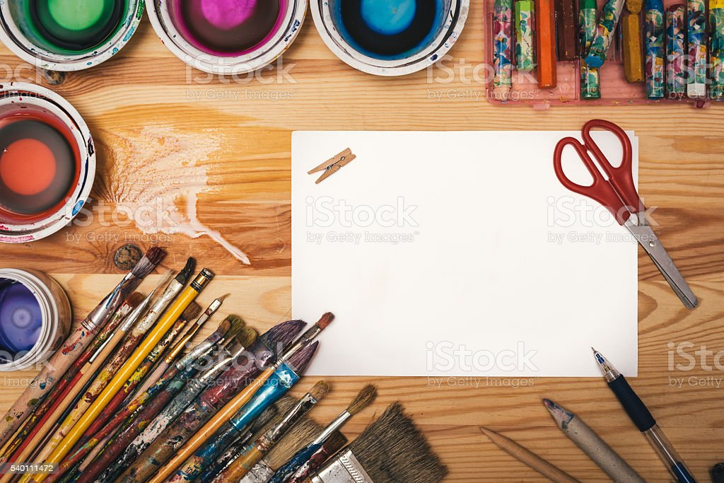 Creative painting workshop tools on wooden board with paper sheet stock photo