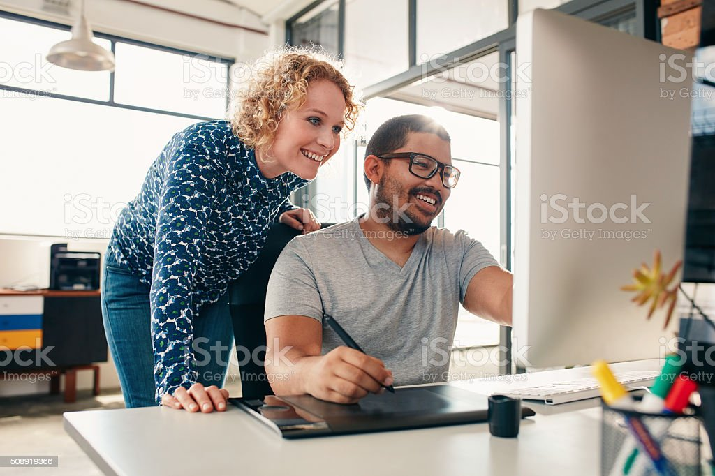 Creative people coworking on a new project stock photo