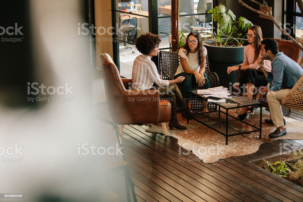 Creative people doing a brainstorming meeting in a modern office stock photo