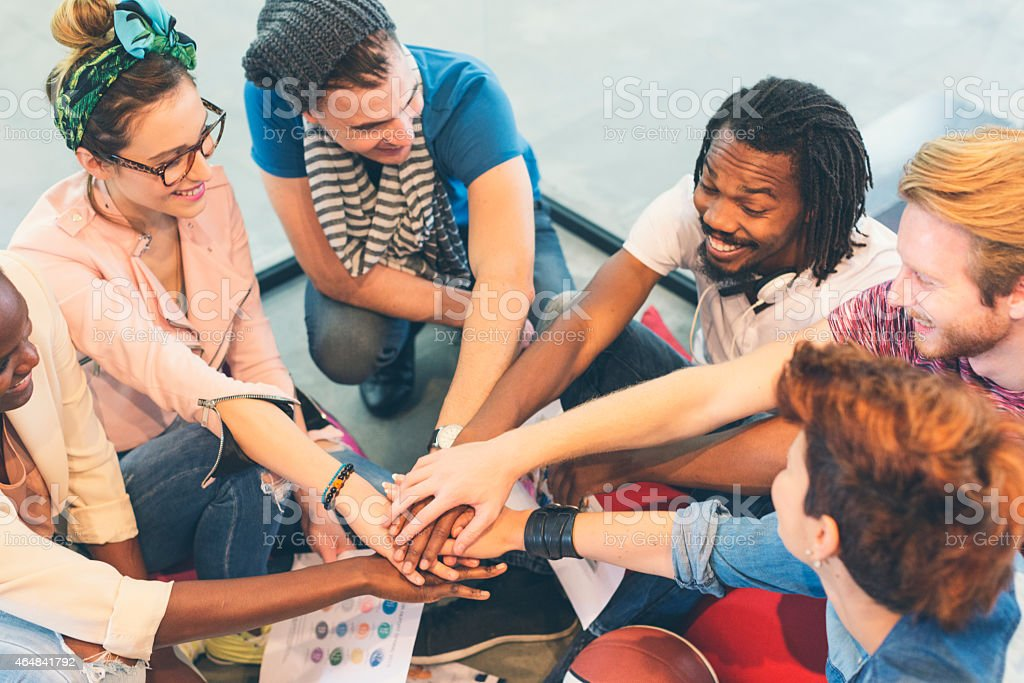 Creative People Joining Hands. stock photo