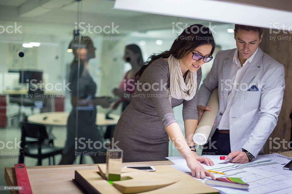 Creative people working in studio stock photo