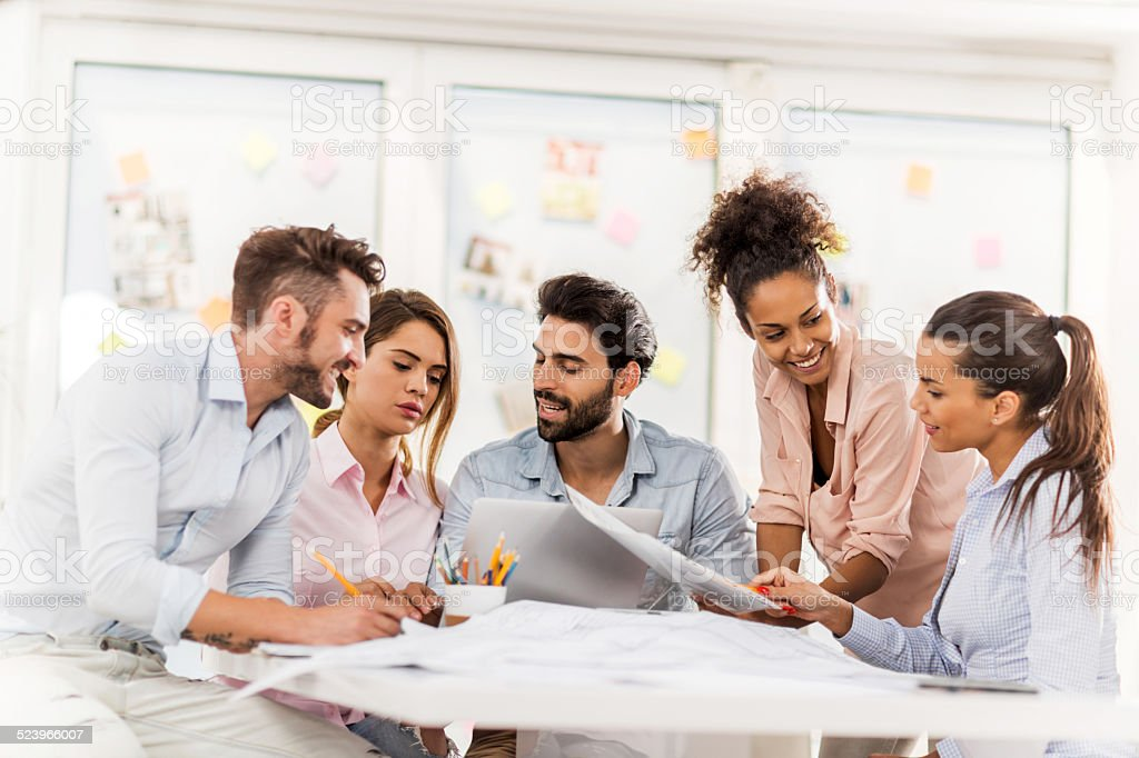 Creative people working on meeting. stock photo