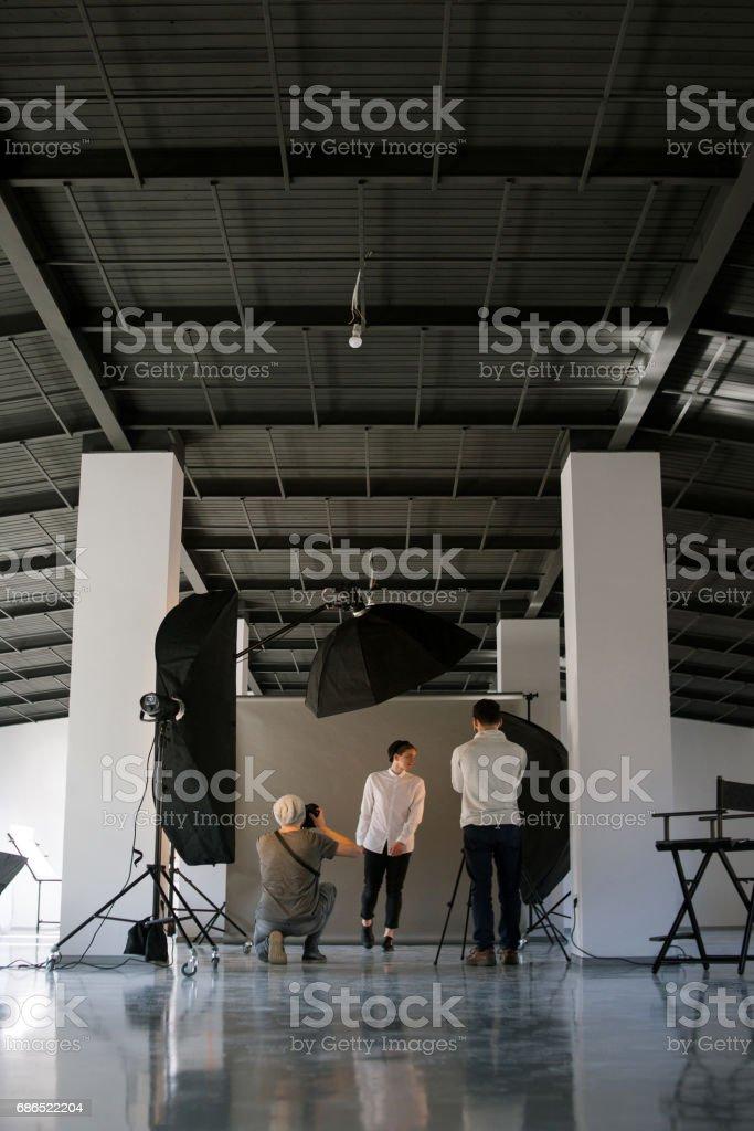 Creative photo and video team shooting in studio stock photo