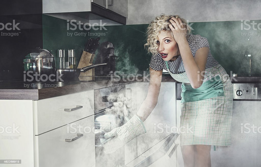 Creative photo of a astonished woman cook frying stock photo