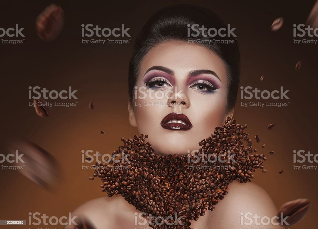 Creative photomanipulation with coffee beans and beauty woman stock photo