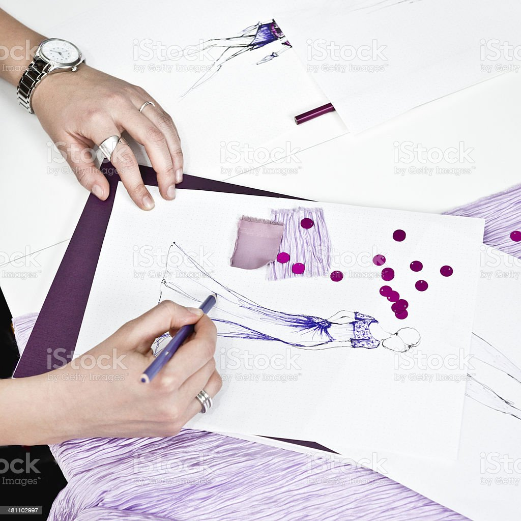 Creative process in fashion design studio stock photo