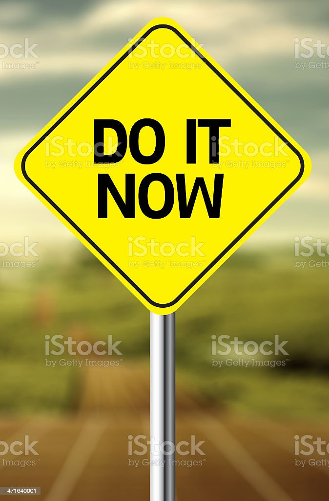 Creative sign with the message - Do It Now royalty-free stock photo