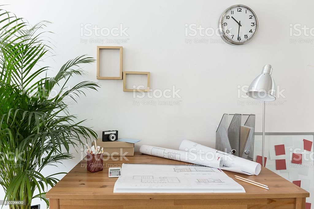 Creative space with house plans stock photo