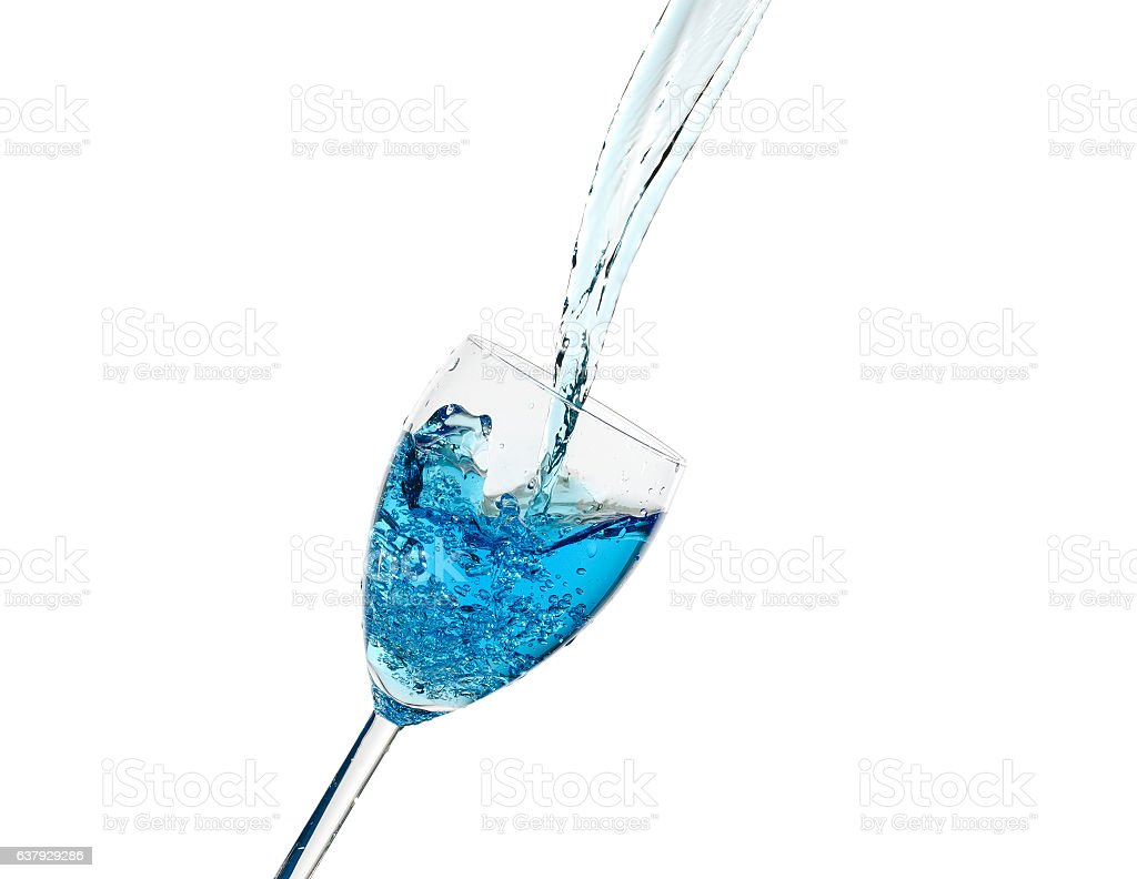 Creative splashing of blue water in the glass stock photo