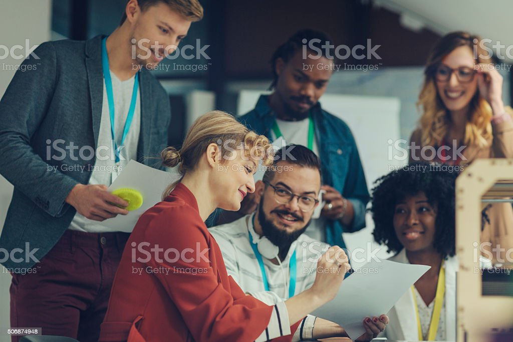 Creative Start-Up Business Team Brainstorming by 3D Printer stock photo