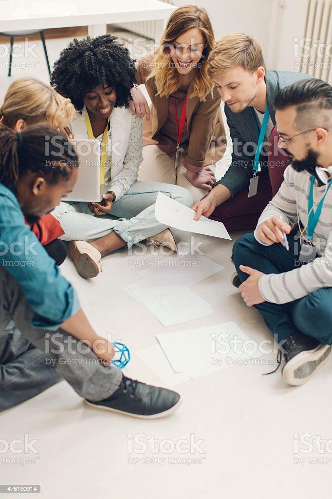 Creative Startup Team Brainstorming On Floor. stock photo