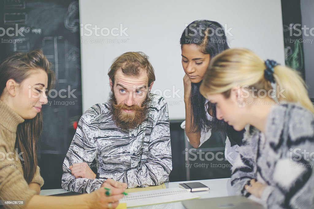 Creative team briefing  at start up office stock photo