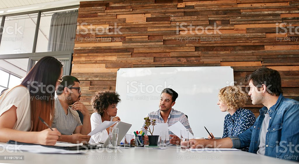 Creative team discussing new strategy of their company stock photo