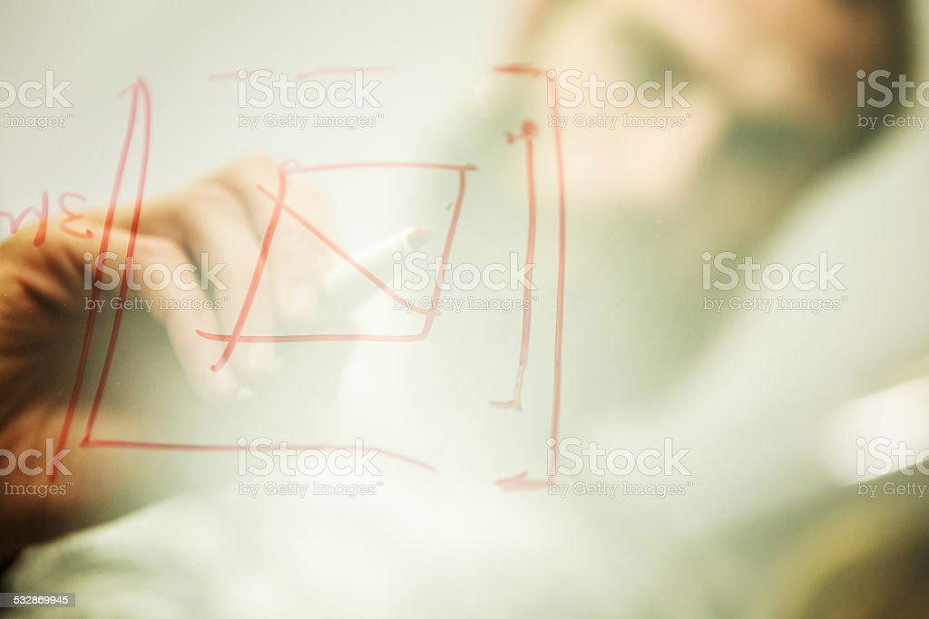 Creative team: drawing a graphic on glass stock photo