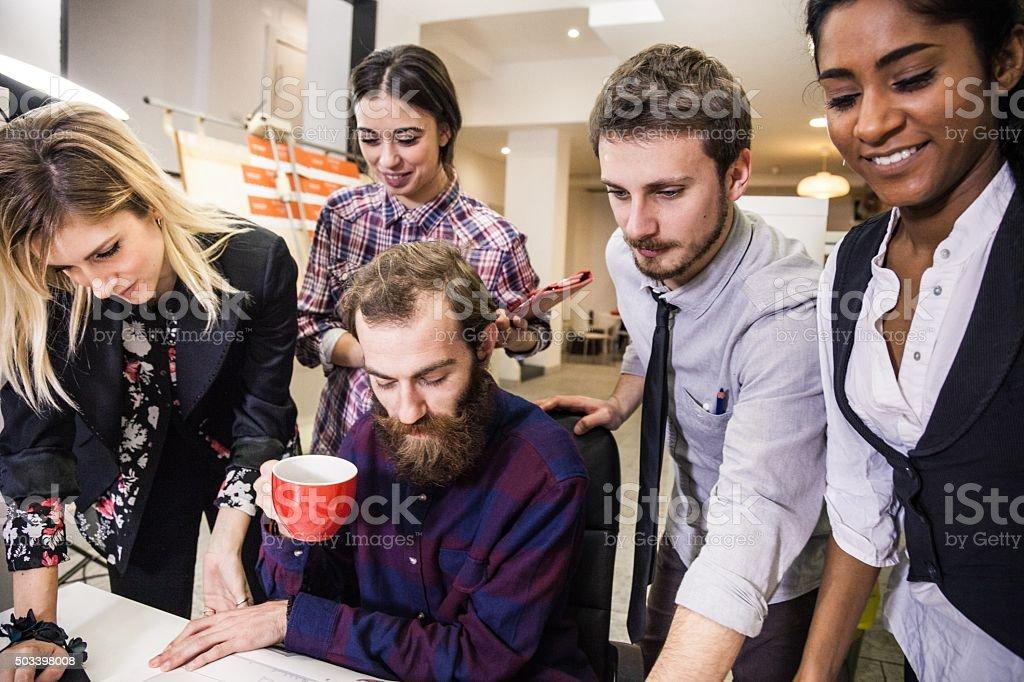Creative team during a break stock photo
