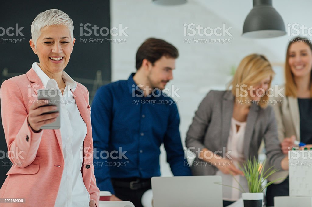 Creative Team Examining Blueprint in the office. stock photo