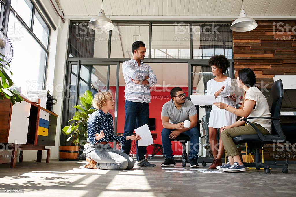 Creative team having a discussion on new project stock photo