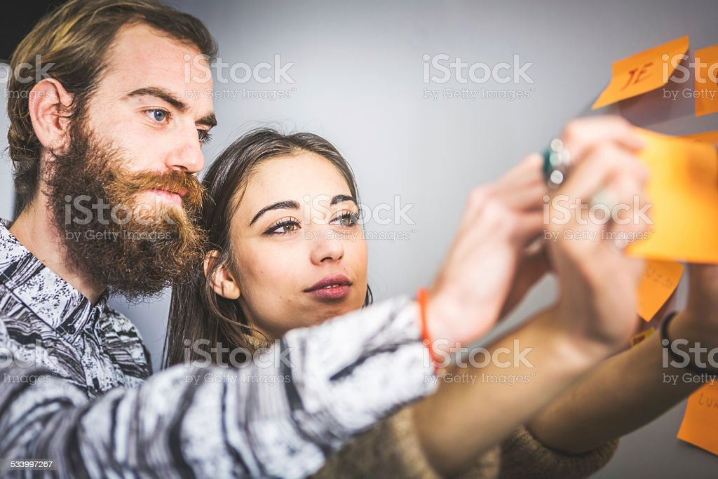 Creative team put notes on the wall stock photo