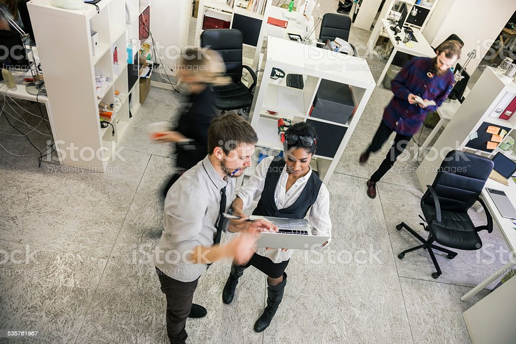 Creative team working in the office stock photo