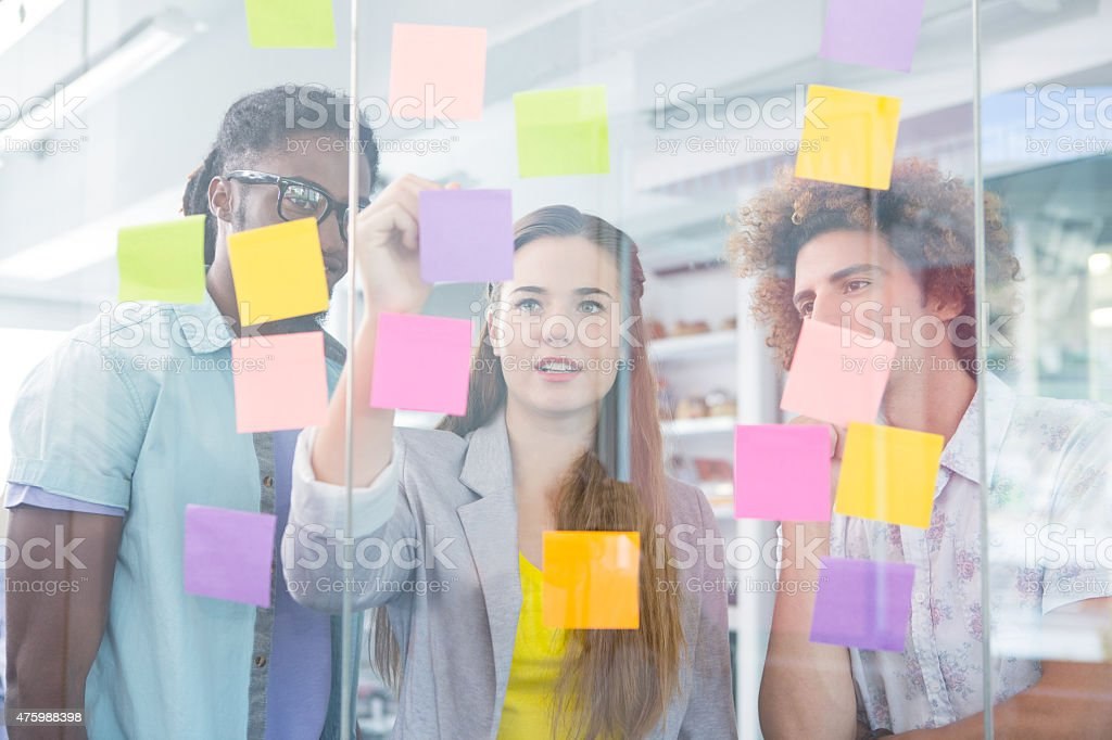 Creative team writing on adhesive notes stock photo
