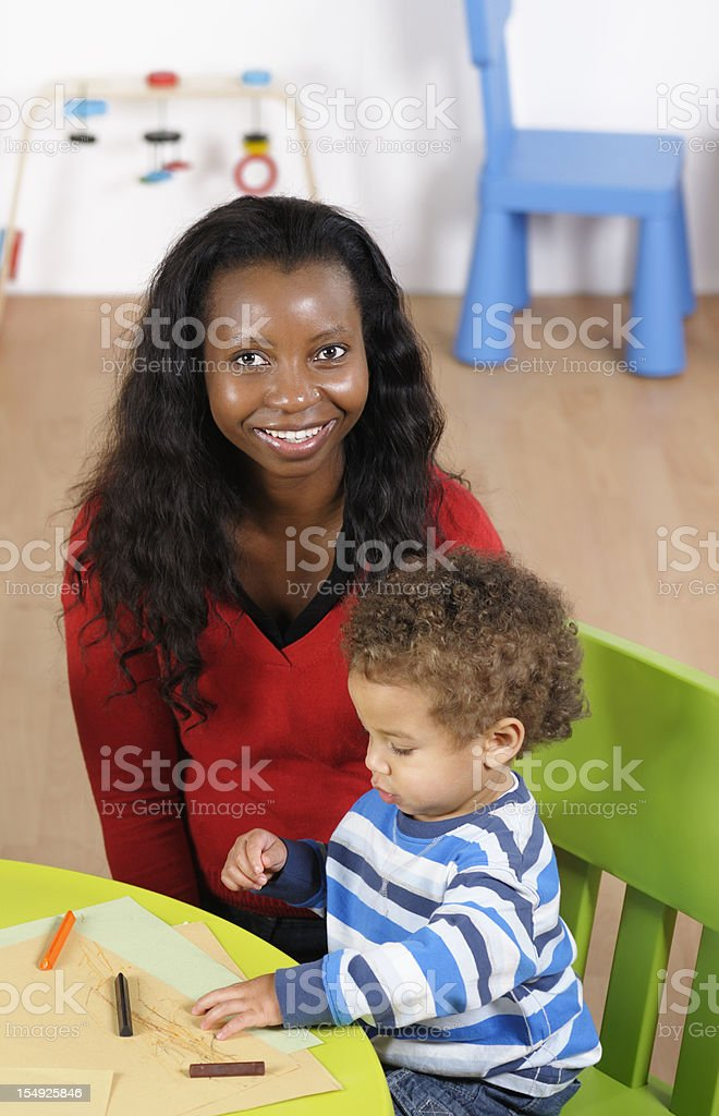 Creative Toddler Doing Artwork In A Nursery Setting royalty-free stock photo