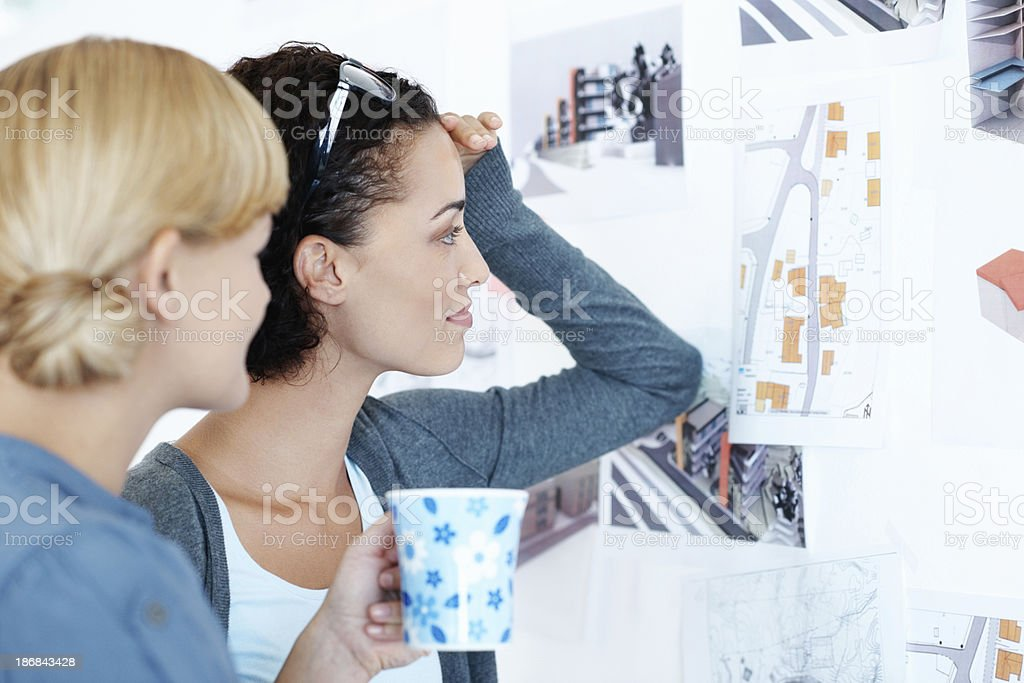 Creative women looking at notes royalty-free stock photo