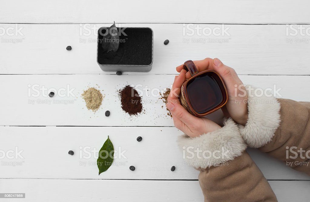 Creative work with cup of boiling water in his hands. stock photo