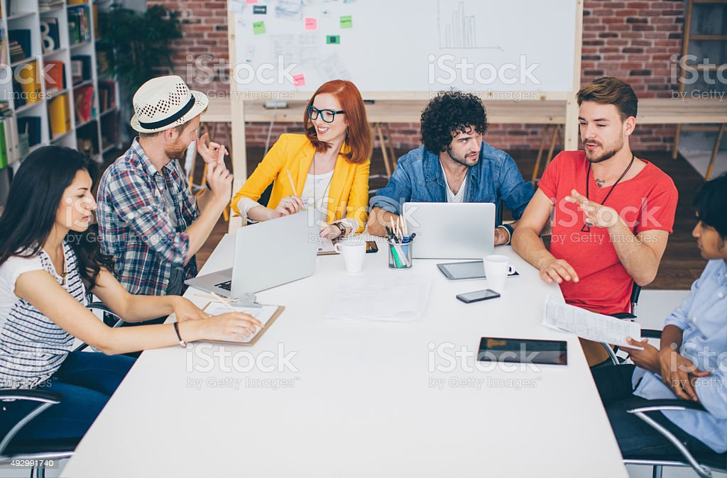 Creative young business people meeting. stock photo