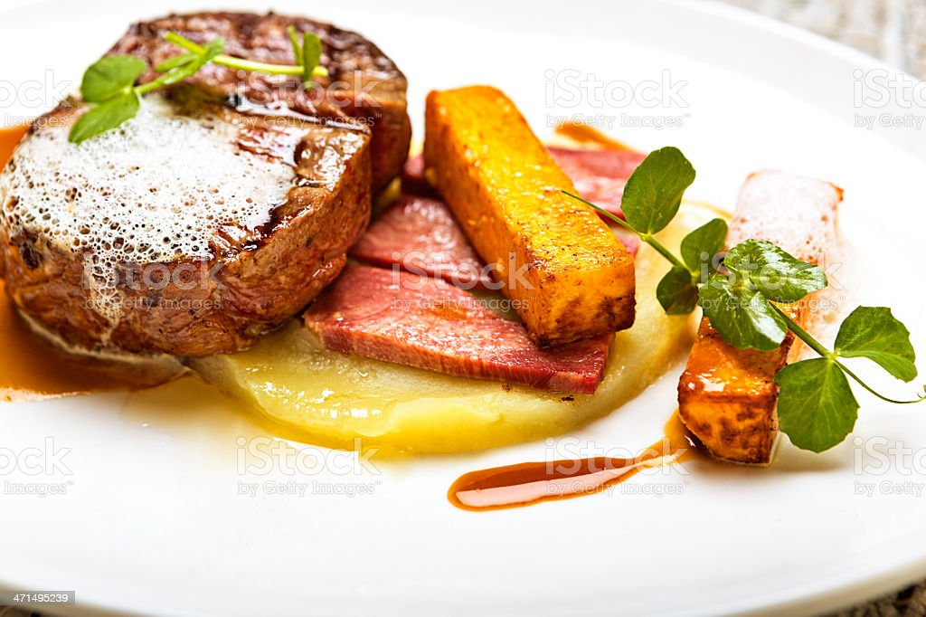 Creatively garnished grilled steak in luxury restaurant royalty-free stock photo