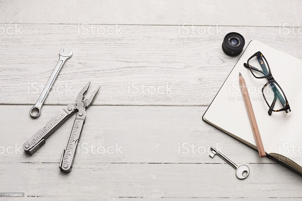 Creativity station with tools, key, blank notebook and pen stock photo
