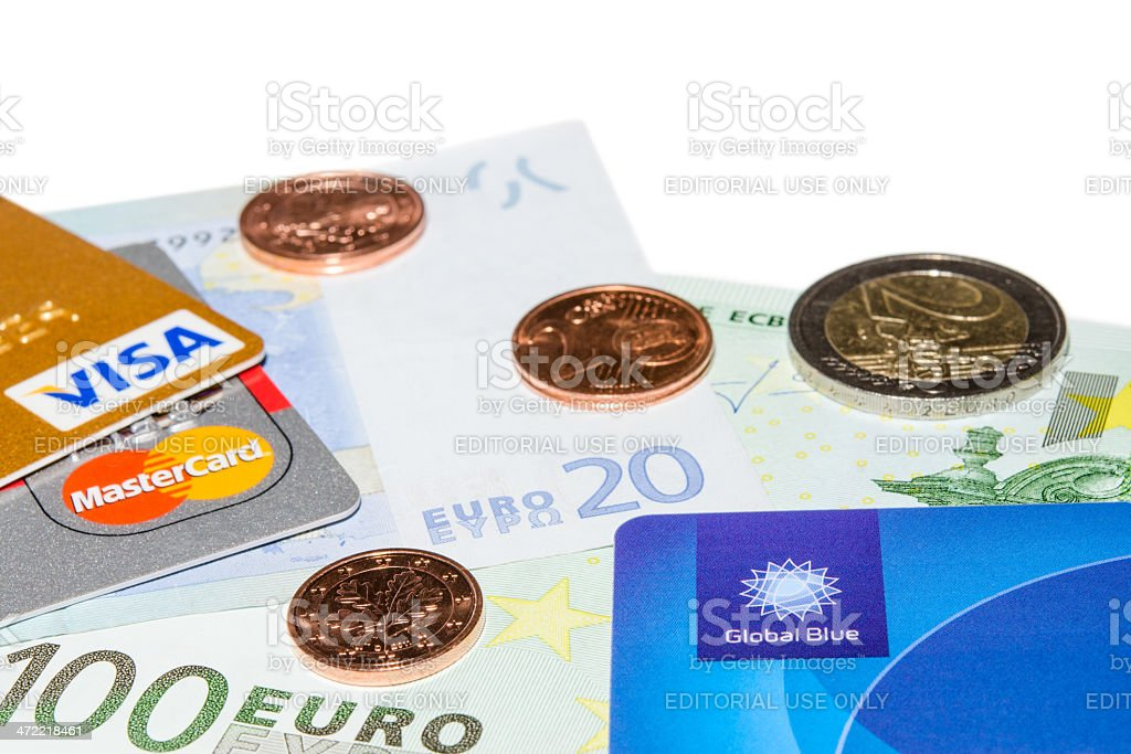 Credit and Tax Free cards on Euro banknotes with coins stock photo