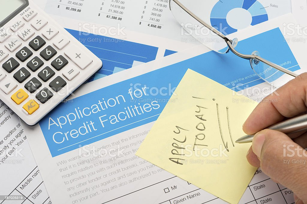 Credit application form with post it note royalty-free stock photo