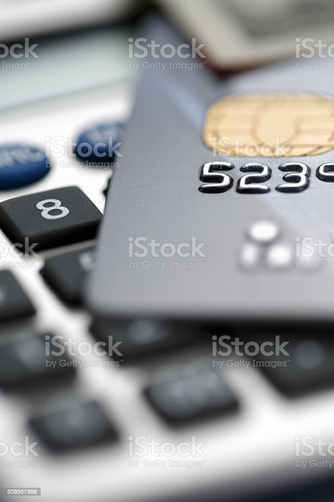 Credit card against Calculator stock photo
