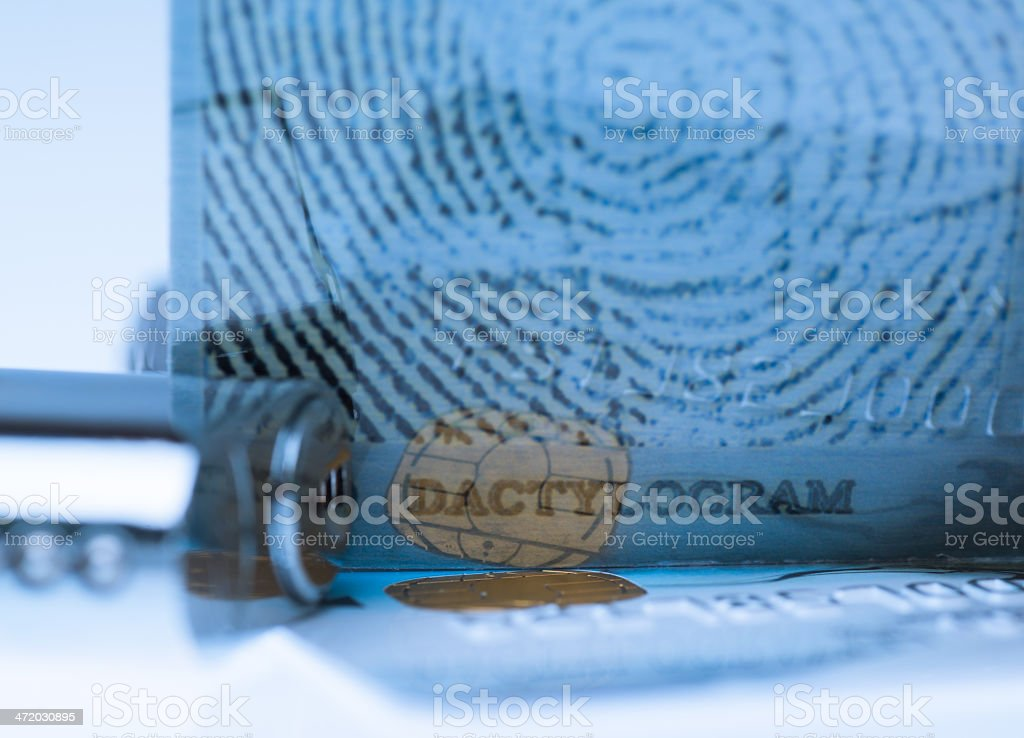 Credit card and dactylogram fingerprint lock royalty-free stock photo