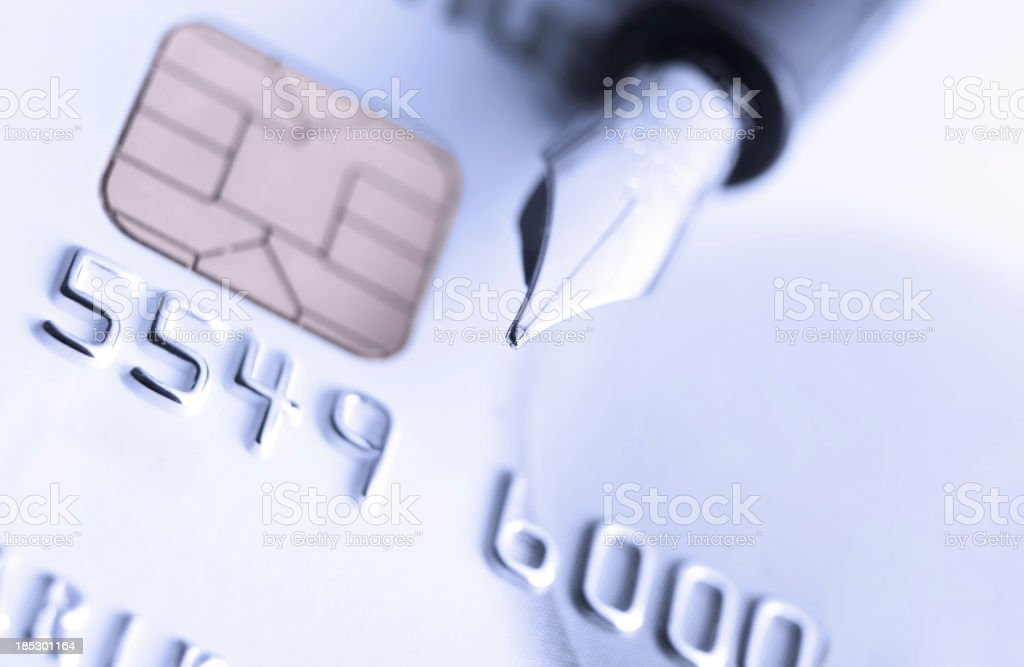 credit card and ink pen stock photo