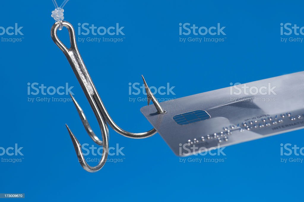 credit card caught in fishing hook royalty-free stock photo