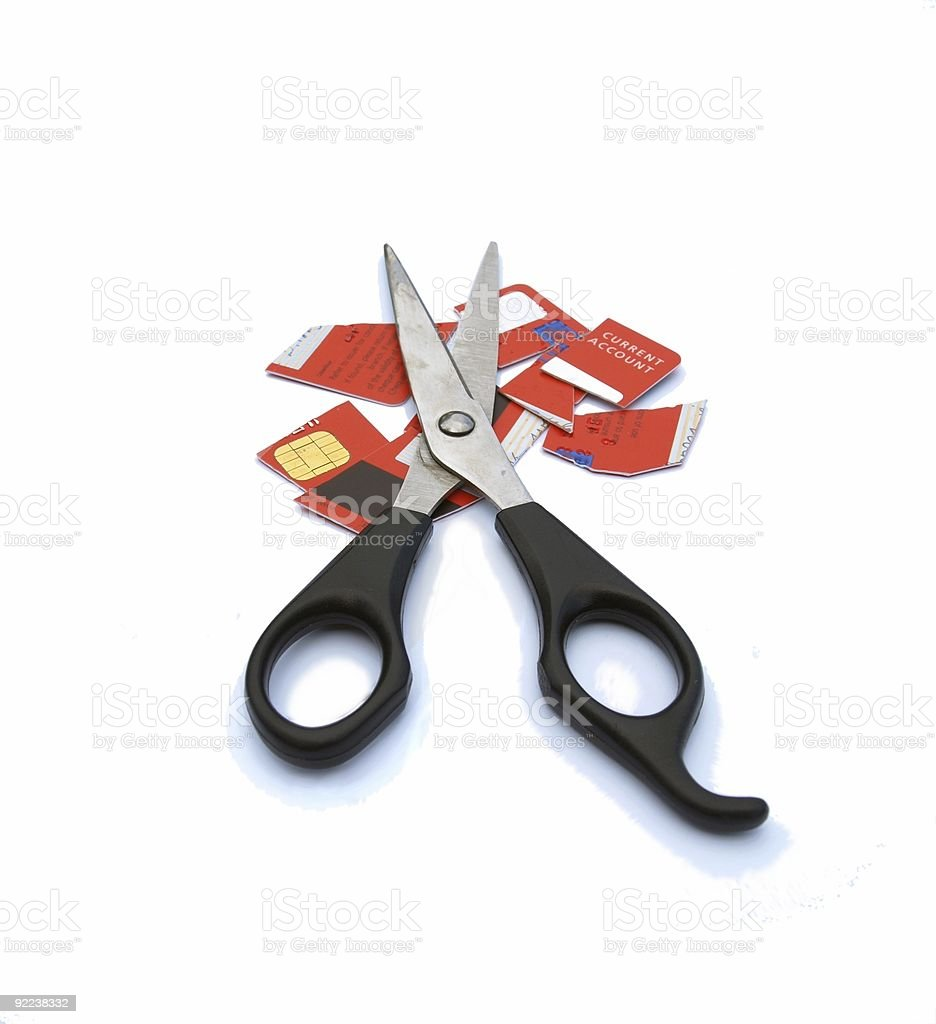Credit card cut up with big scissors. stock photo