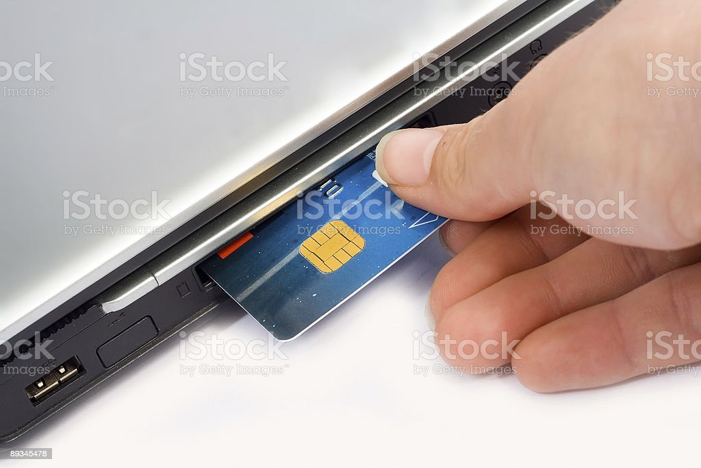 Credit card inserted in laptop - Concept for Internet Banking & royalty-free stock photo