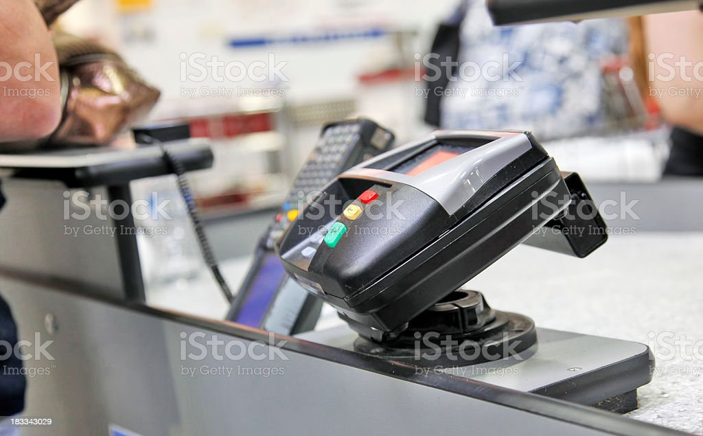 Credit card machine at store checkout line stock photo