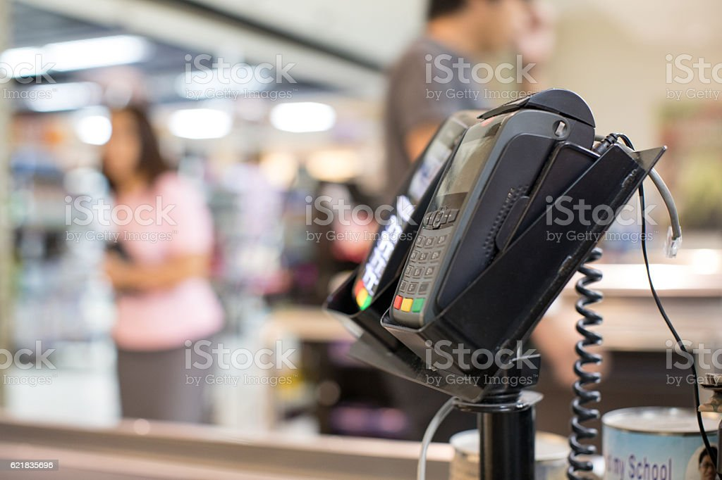 Credit Card Machine on cashier counter in the store stock photo