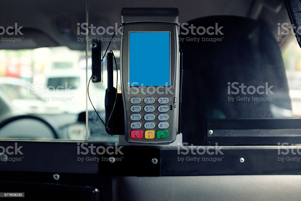Credit Card Machine on Taxi Cab stock photo