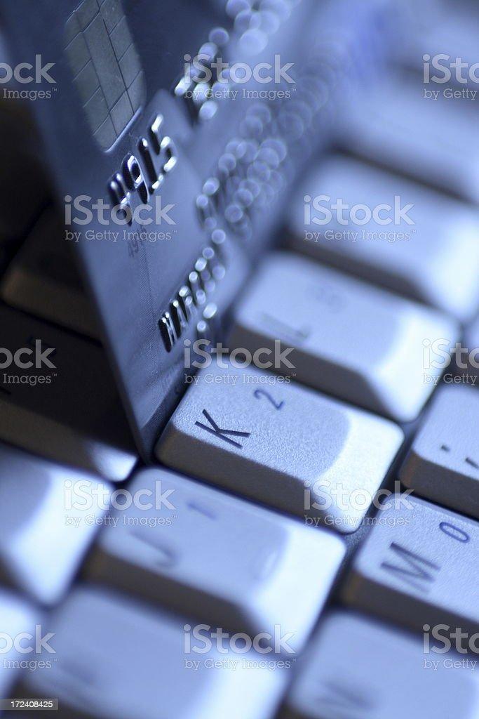 credit card on computer keyboard royalty-free stock photo